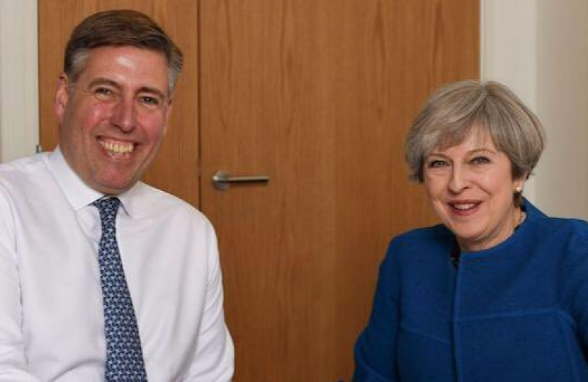 Sir Graham with Theresa May